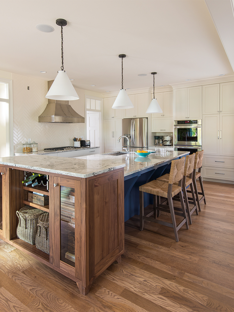 White Kitchen with Blue Island and Light Stain Cabinet