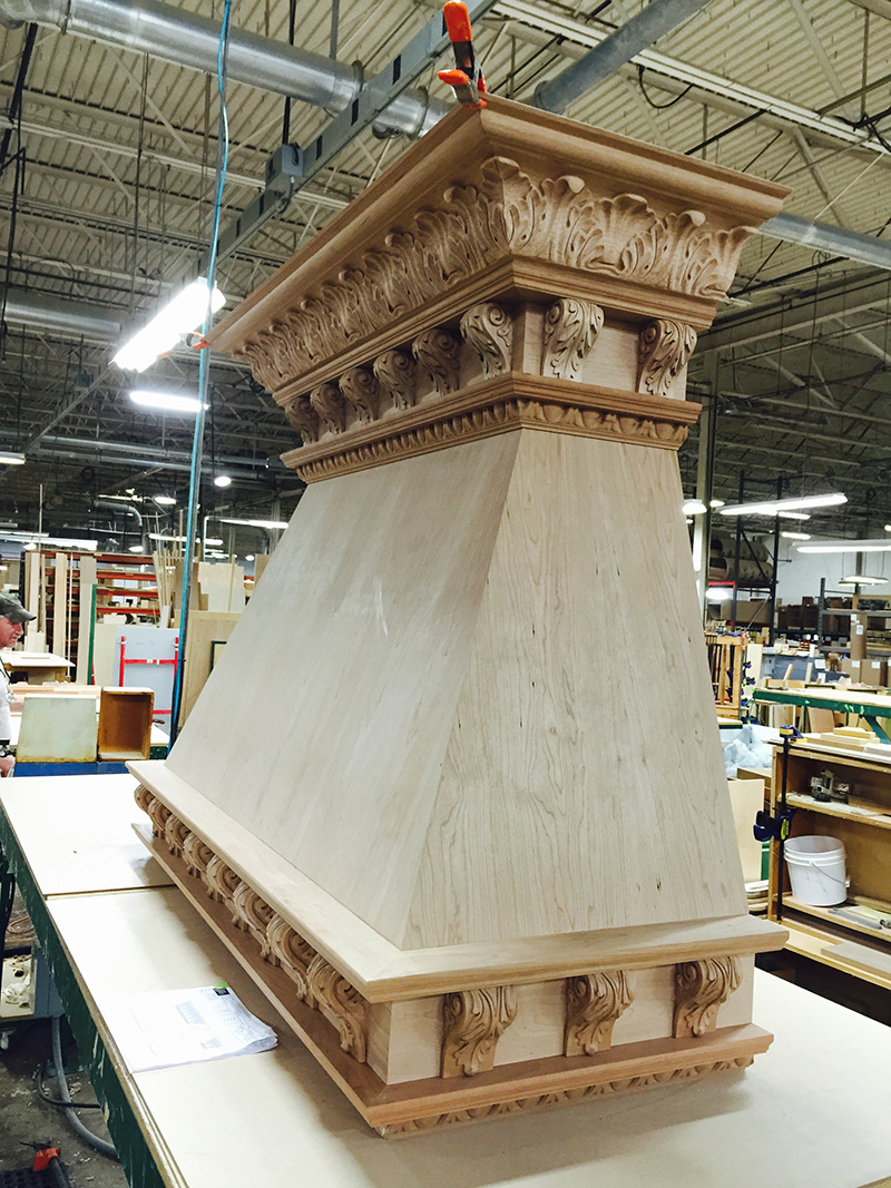 Wide Picture of Raw Wood Range Hood with Corbels