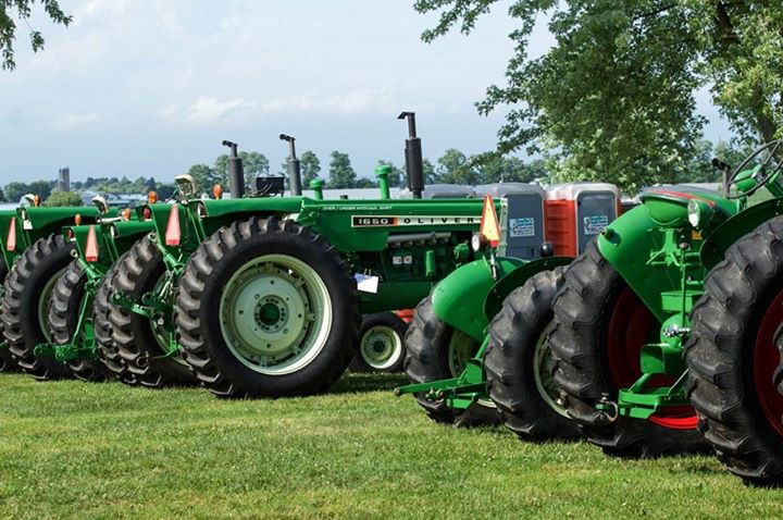 Green Tractors on Display in Rural Field