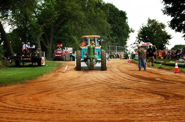 A participant Pulls the Sled in the Tractor Pull Competition
