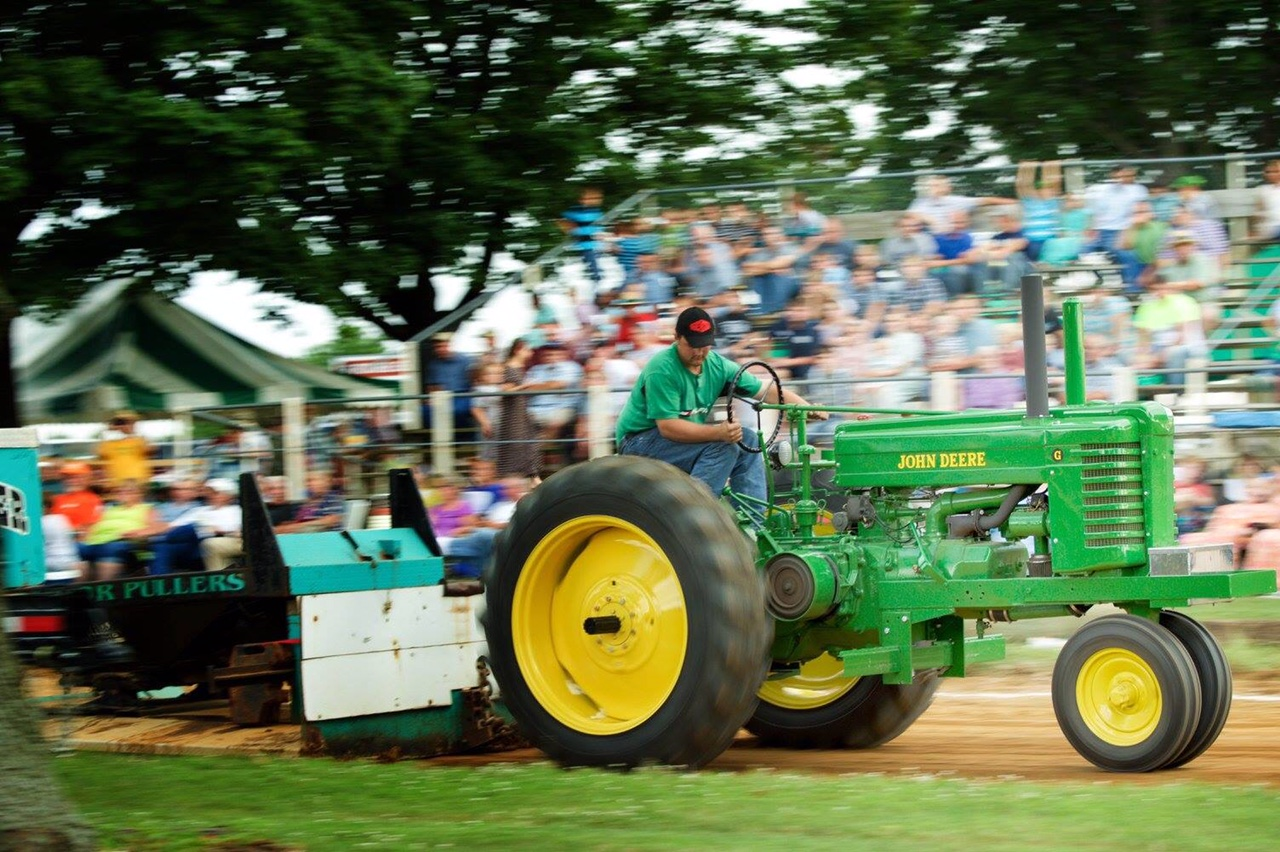 Tractor Pulling Sled in the Mud During this Contest