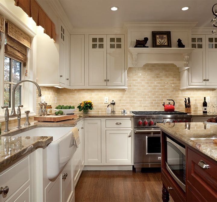 Cabinets with subtle sophistication plain fancy cabinetry for Buttercream kitchen cabinets